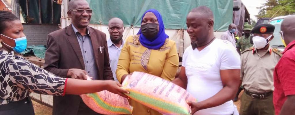 Chairman Lc V Rev Hn PETER BAKALUBA Togather with Madam RDC NABITAKA NDISABA  Handing over seeds for operation wealth creation
